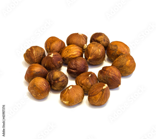 Heap of hazelnuts .