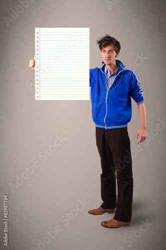 Young man holding white paper copy space with diagonal lines