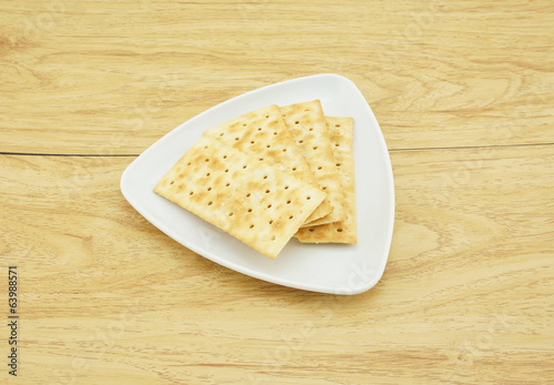 Square crackers in a white plate