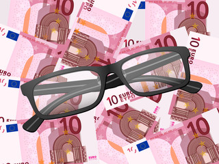 reading glasses on ten euro background