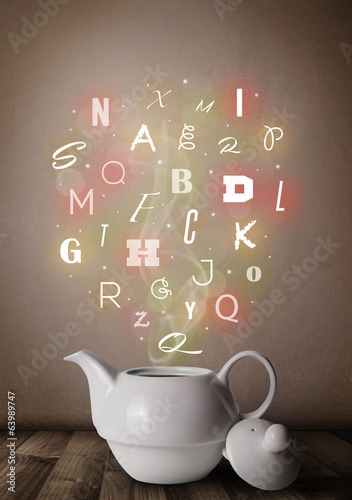 Tea pot with colorful letters