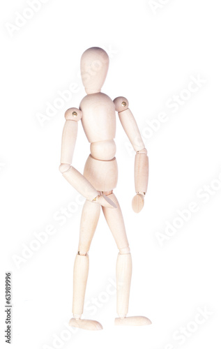 Figure of the wooden little man on a white background