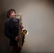 Young musician playing on saxophone - 63990186