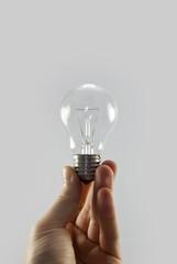 holding light bulb isolated on white background