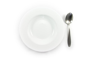 Empty white plate with the spoon on white background