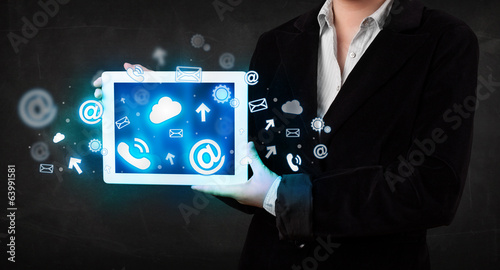 Person holding a tablet with blue technology icons and symbols