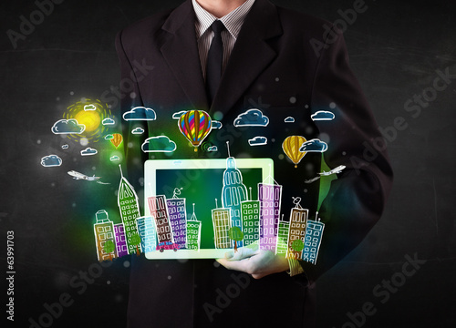 Young person showing tablet with hand drawn cityscape