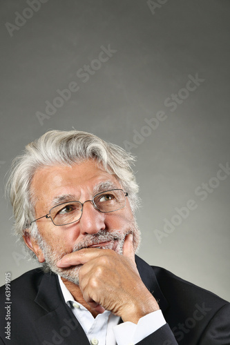 Pensive portrait of a senior man