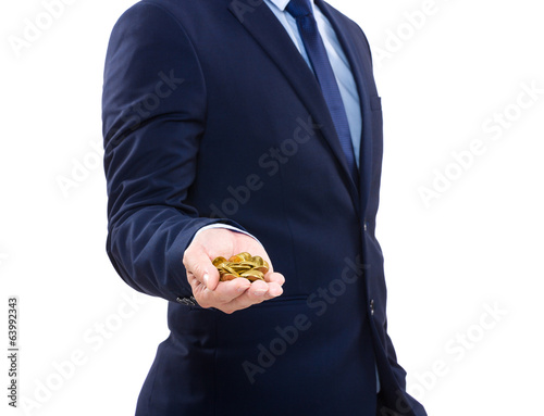 Businessman holding gold coin
