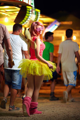 beautiful girl walking on music festival, youth culture