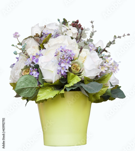 white roses and flower accessories decorated in green jug isolat
