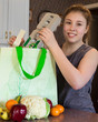 Girl unpacking healthy food from reusable bag