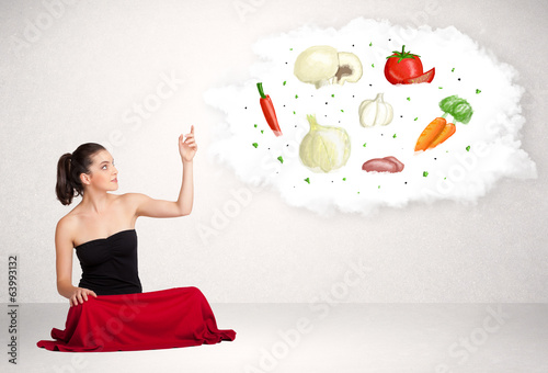 Young business woman presenting cloud with nutritional vegetable