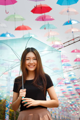 Asian girl with umbrellas
