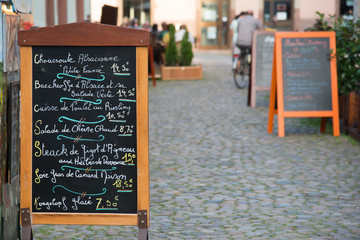 Menu stand with local specialties on Strasbourg street