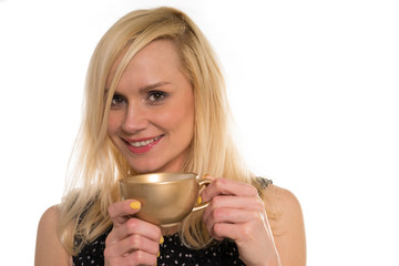 Beautiful woman drinking from a golden cup