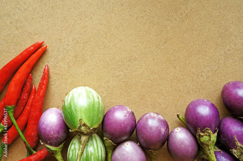 Red chili and tomatoes on wooden table