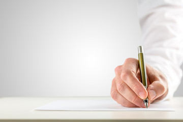 Hand holding a ballpoint in order to start writing