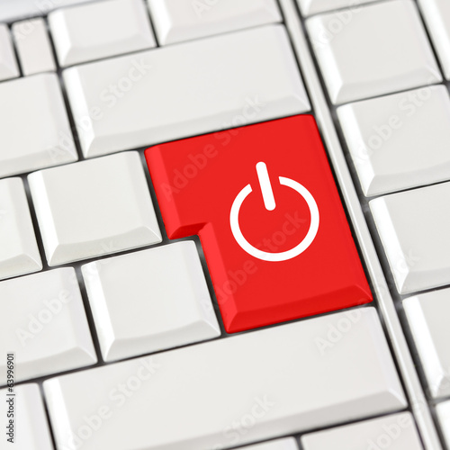 Red power icon on a computer keyboard
