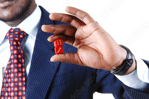 Closeup of man holding dice.