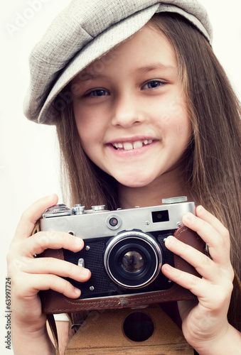 child and a photo camera