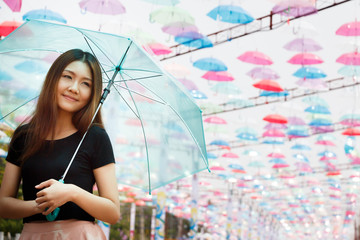 Beautiful Aisan girl with umbrellas