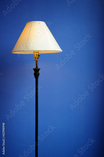 Modern lamp in a blue wall