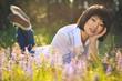 Beautiful asian girl relaxing among flowers