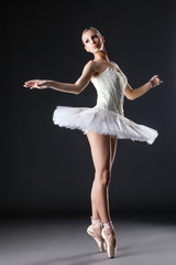 Image of cute young ballerina dancing in studio