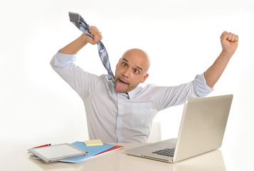 bald attractive business man desperate with computer at work