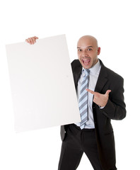 bald latin businessman holding blank sign for advertisement