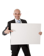 bald latin businessman holding blank sign for advertisement