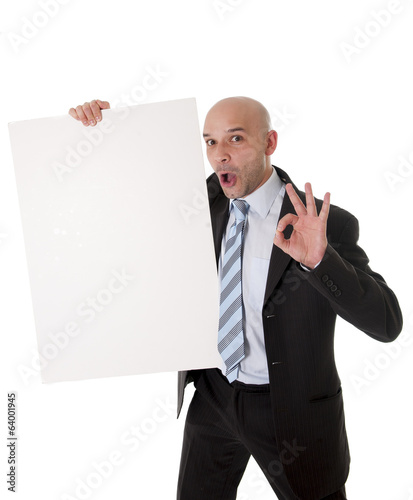 bald latin business man holding blank sign for advertisement