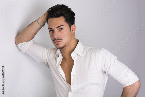 Elegant attractive young man with white shirt
