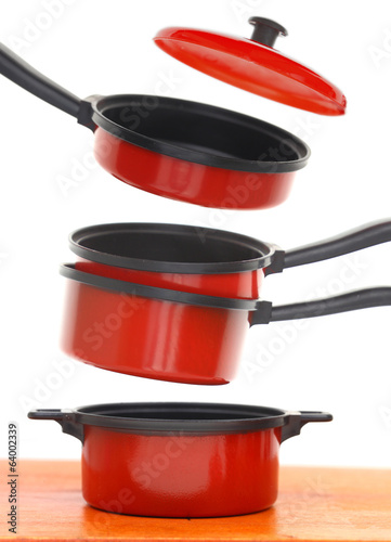 Red cookware set on white background - 64002339