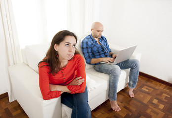 latin girlfriend not happy with boyfriend playing on laptop