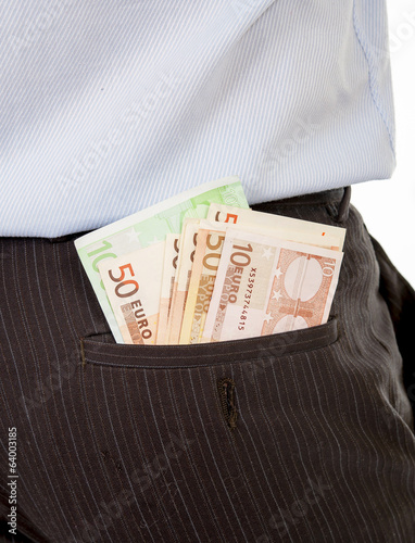 macro of euro banknotes in businessmans back pocket.