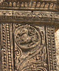 ancient bas-relief with mythical creature on the facade of ancie