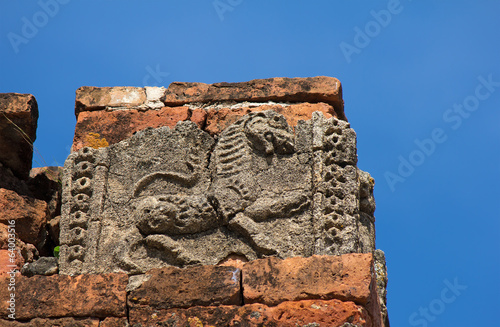 old cracked bas-relief of lion on the facade of ancient temple