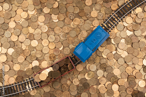 coins background and toy train