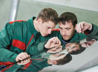 Windshield repair workers