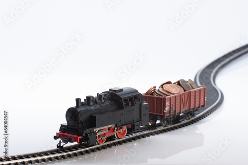 toy train with coins three