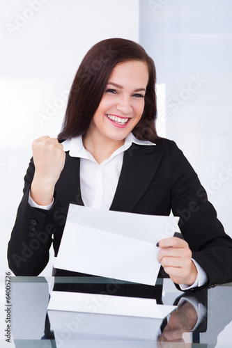 Happy Businesswoman Reading Document