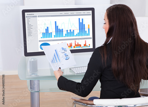 Businesswoman Analyzing Charts