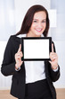 Businesswoman Showing Tablet