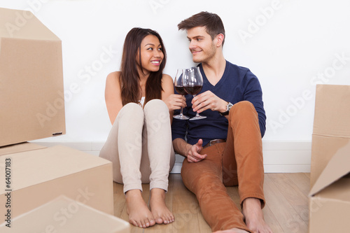 Couple Toasting Wineglasses In New Home