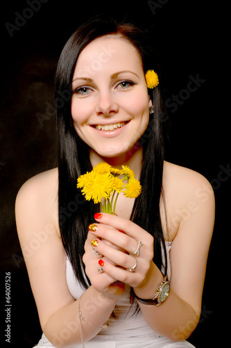 woman holding dandelion in studio