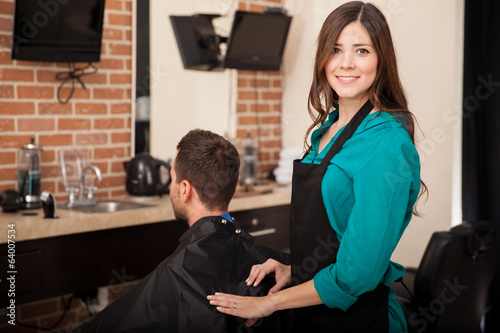 Cute lady barber at work