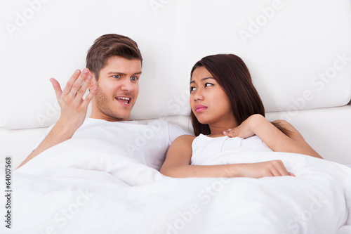 Angry Man Shouting At Upset Woman