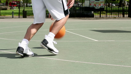 Low angle of basketball player dribbling the ball
